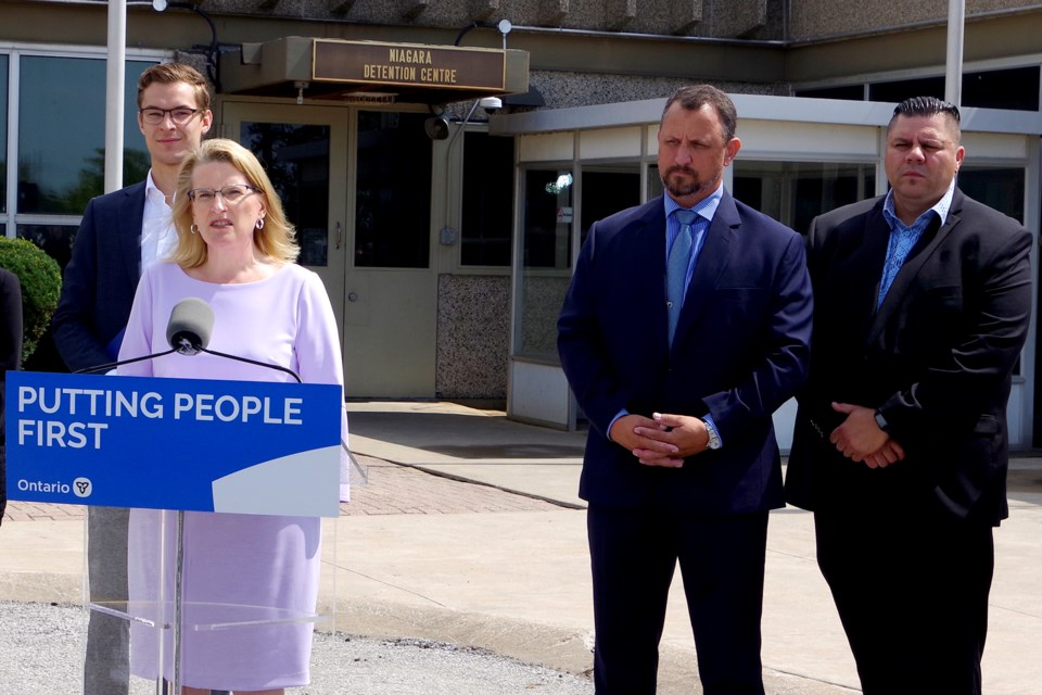Ontario Solicitor General Sylvia Jones made an announcement of new institutional security teams in the Niagara Detention Centre. She is flanked by Niagara West MPP Sam Oosterhoff (l), OPP Detective Sgt. Grant McNair and Union President Marko Mrmak (r). Bob Liddycoat / Thorold News