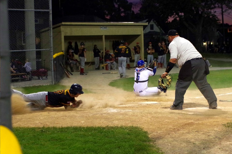 Thorold's Dan Boekestyn is thrown out sliding home setting the tone early for a 14-3 loss in tournament opener. Bob Liddycoat / Thorold News
