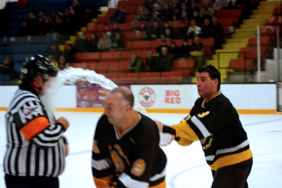 Referee Derek Bowyer gets a bucket of water in the face in a game that featured more hijinks than hockey. Bob Liddycoat / Thorold News