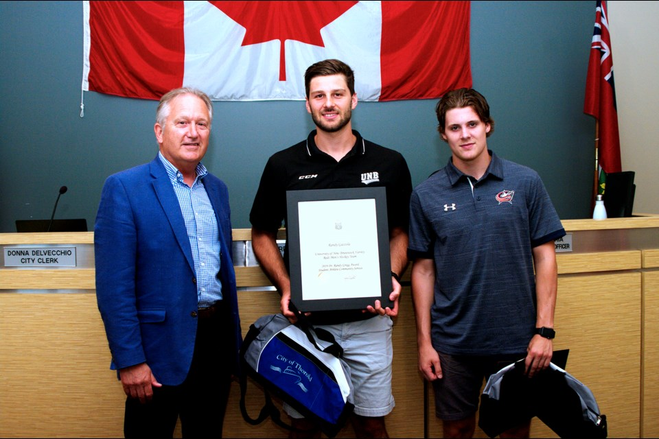On behalf of City Council, Mayor Terry Ugulini (l-r) recognized Randy Gazzola and Tyler Angle for their accomplishments. Bob Liddycoat / Thorold News