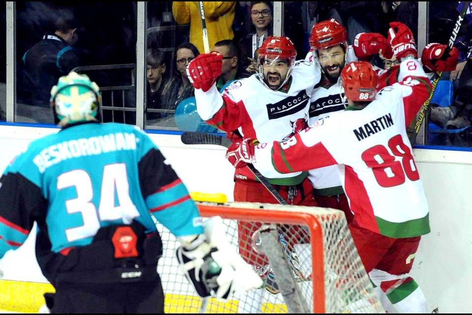 Sean Bentvoglio (l) and Joey Martin (r) celebrate Mike Hedden's (c) first period goal. Cardiff Devils Photo