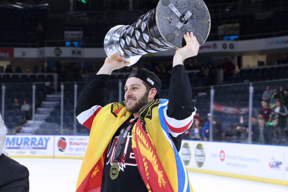 Thorold native Randy Gazzola hoists the David Johnston University Cup after his UNB Reds captured the national university hockey title. Submitted Photo