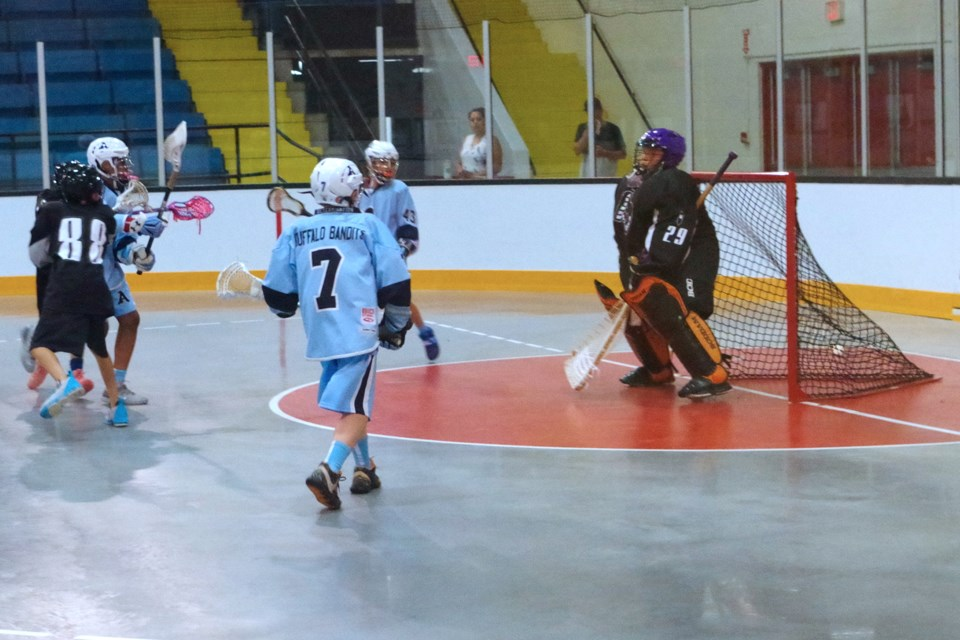Xavier Peters (left in blue) of the St. Catharines Athletic Peewees puts the ball past Six Nations goalie Jordin Martin. Bob Liddycoat / Thorold News