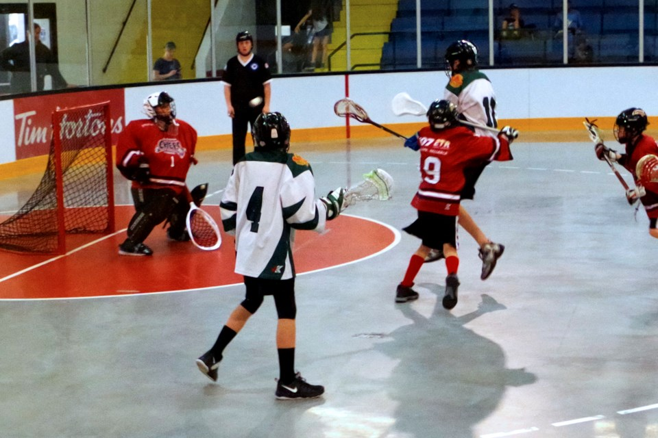 Reichen Thorpe (#11 White ) scores to put Gloucester up 4-1 in a game against Burllngton in peewee action. Bob Liddycoat/ Thorold News