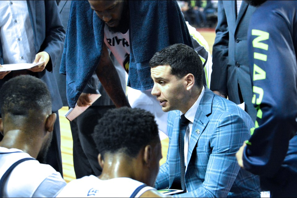Coach Victor Raso draws up a play during a timeout. Stephen Dyell / Thorold News