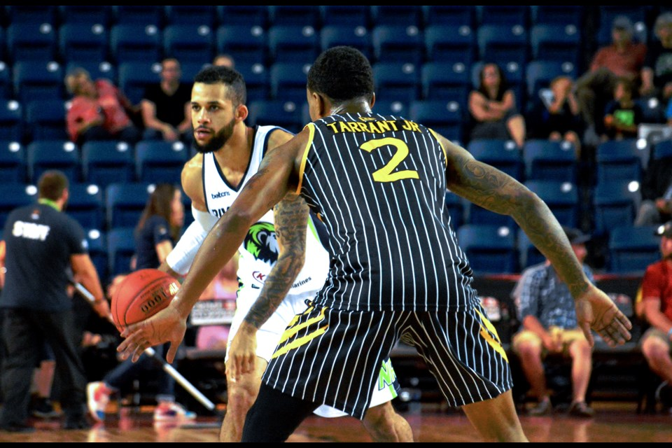 Niagara's Kassius Robertson dribbles up the court. Stephen Dyell / Thorold News