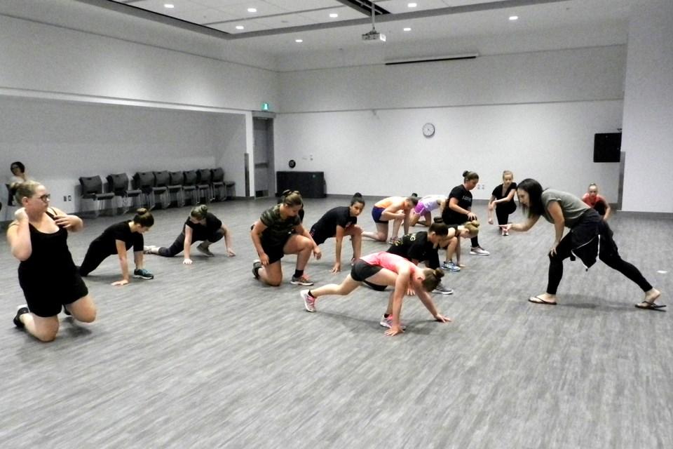 Tia Arsenault takes the Matrix juvenile skating team through some dryland training. Bob Liddycoat / Thorold News