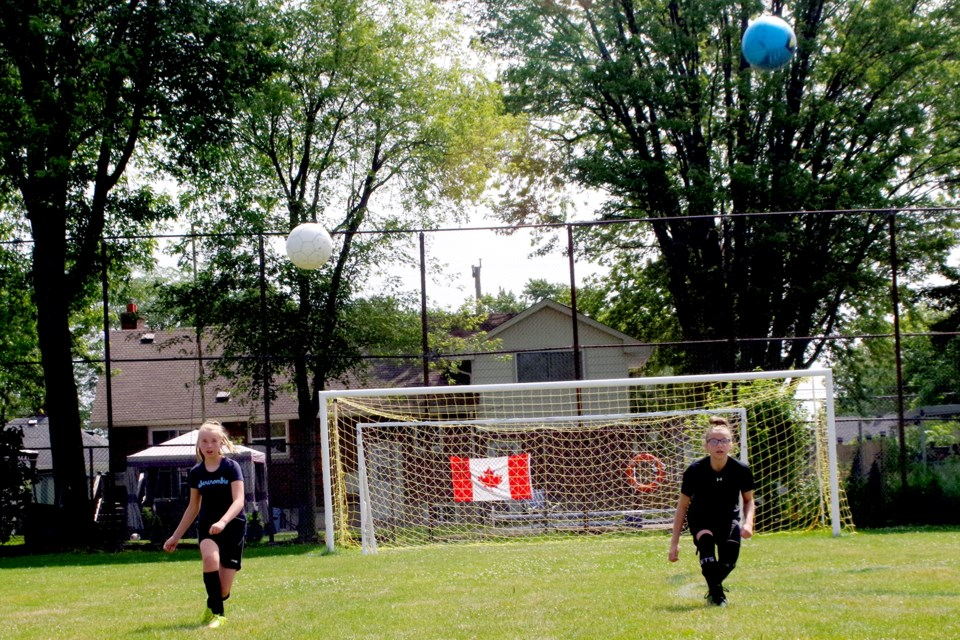 Double trouble as Isabella Pickett (r) and Katelyn Chamberlain kicked it up a notch at soccer camp. The two Monsignor Clancy students play for the Jets in St. Catharines. Bob Liddycoat / Thorold News