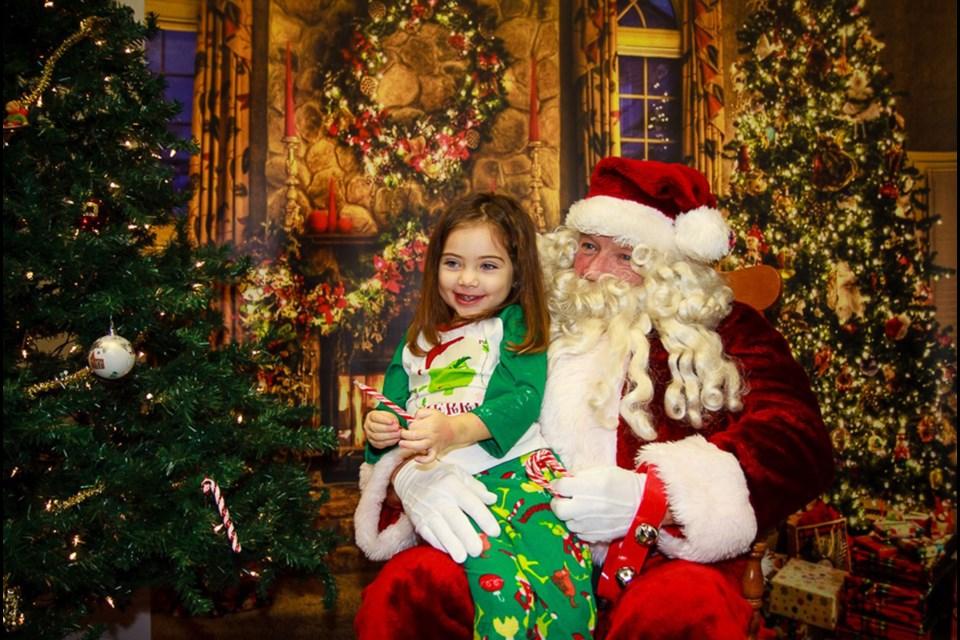 Kids flocked to Santa at Port Robinson  kids' party. Bob Liddycoat / Thorold News