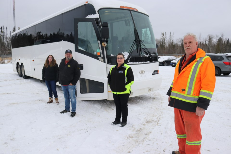 The Yo Mobile's Huguette Bois and Mario Dussault, and Tisdale Bus Lines' operations co-ordinator Kim Boucher and maintenance supervisor Chris Byrnes stand next to a bus donated to The Yo Mobile. Dariya Baiguzhiyeva/TimminsToday
