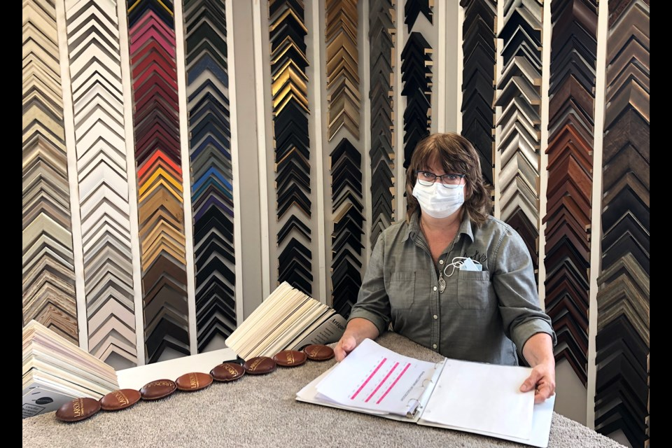 Artsie owner Dale Morrish enjoys working in the custom framing area of the new location of her store at 360 Algonquin Blvd. in Timmins.