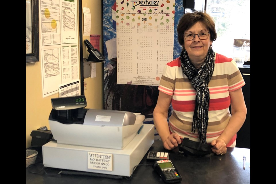Madeleine Lavergne stands by the checkout at The Broadway Diner in Timmins. She and her husband Maurice have owned the restaurant since 1997.