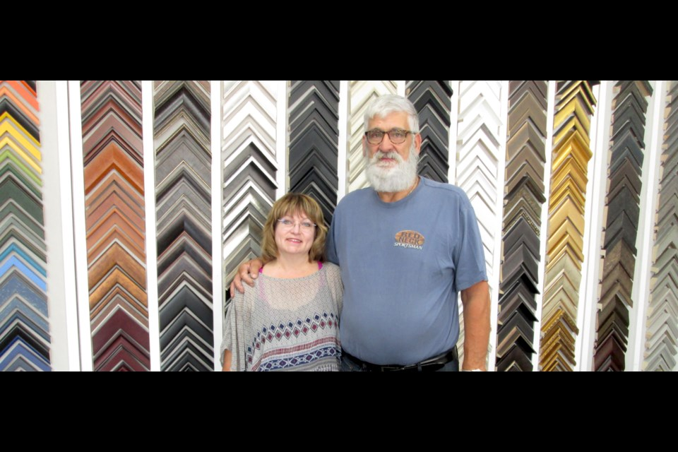 Dale and Dave Morrish pose in front of a wall full of frame samples at Artsie, her new shop at 75 Pine St. South in Timmins. In addition to custom framing, Artsie sells art supplies, artwork and more. The new storefront opened last week. Wayne Snider for TimminsToday