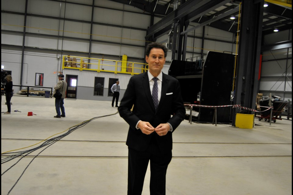 """Steve Paikin, host of TVO's """"The Agenda"""" standing in the midst of the cavernous The Bucket Shop facility that served as the backdrop for a discussion on Timmins and region's economy. Frank Giorno for TimminsToday."""
