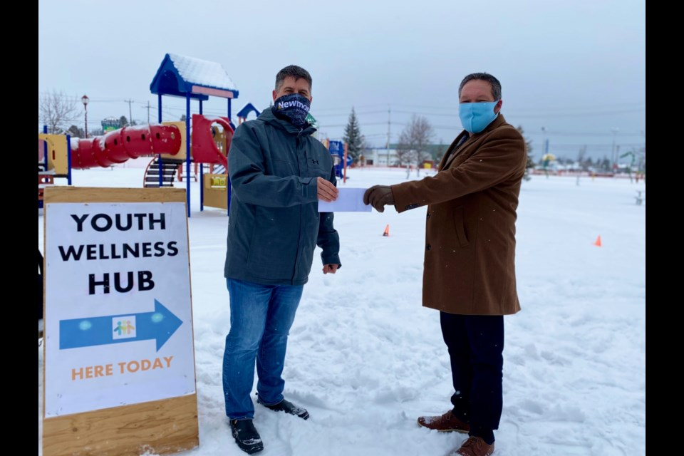 Newmont Porcupine's Bryan Neeley, left, and Cochrane District Social Services Administration Board CAO Brian Marks. Newmont Porcupine recently donated $50,000 to the Youth Wellness Hub in Timmins. Supplied photo