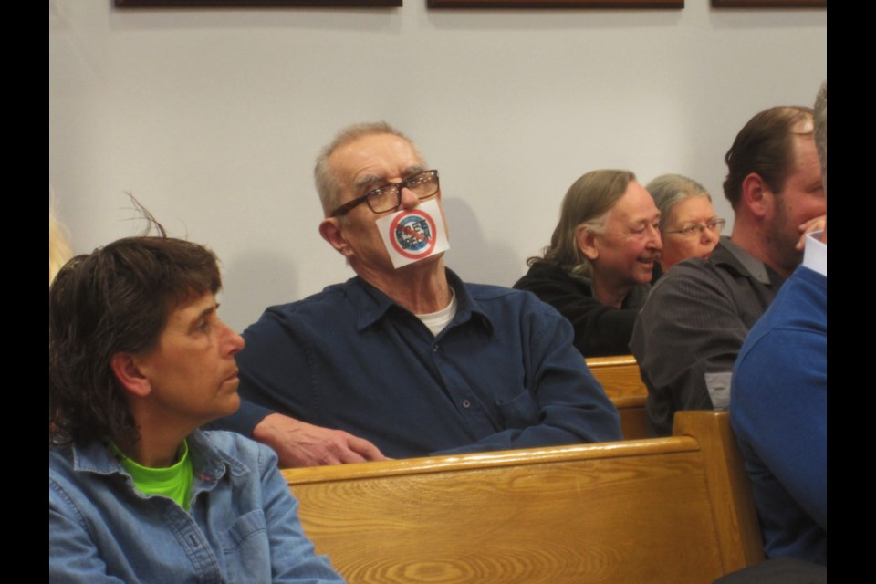 Concerned citizen John Ivanovs, seen here sitting in the audience with an anti free speech seal over his mouth, had many things to say on Monday. Andrew Autio for TimminsToday