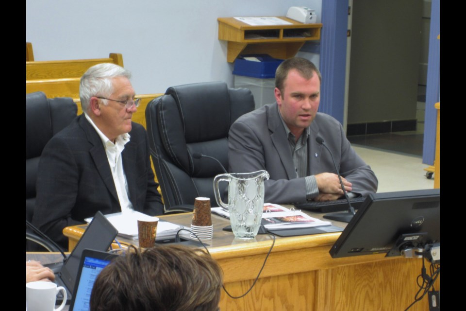 Mayor Steve Black (right) addresses council on Monday night, regarding the city's commitment of $3.5 million dollars towards an 8-day fireworks festival in 2017. David Whysall, a fireworks promoter from Niagara Falls sits on his left. Andrew Autio for TimminsToday