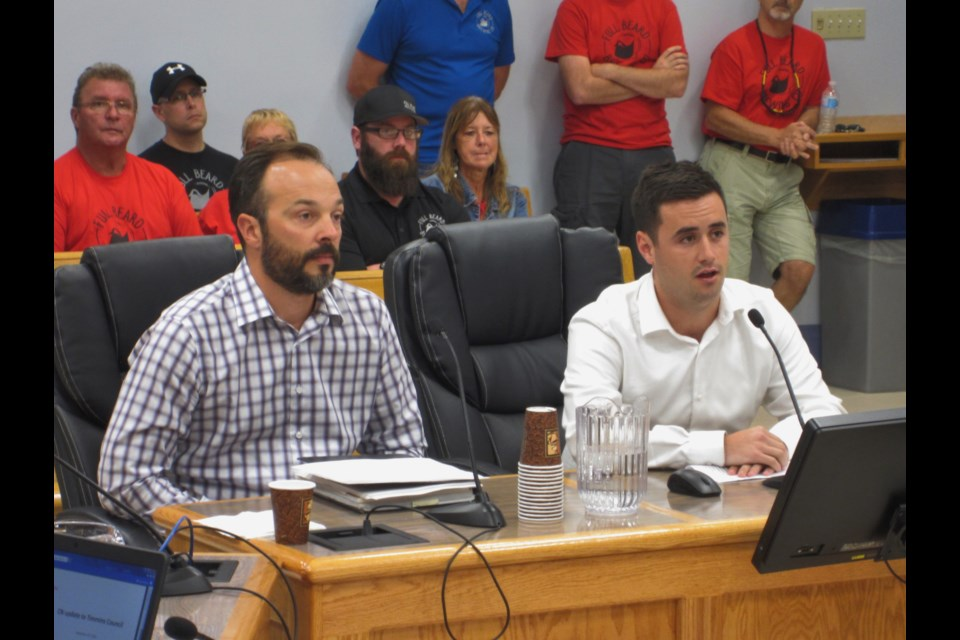 CN Environmental Officer Aaron Stadnyk (left) and a fellow CN employee who did not identify himself speak at city hall. Andrew Autio for TimminsToday