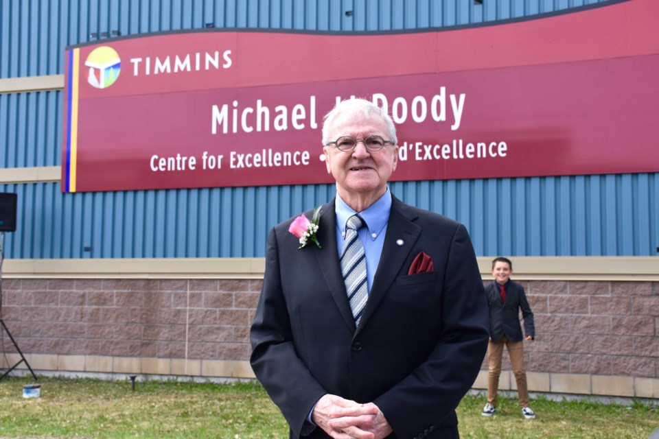 Mike Doody proudly stands near the sign bearing his name downtown Timmins. Maija Hoggett/TimminsToday