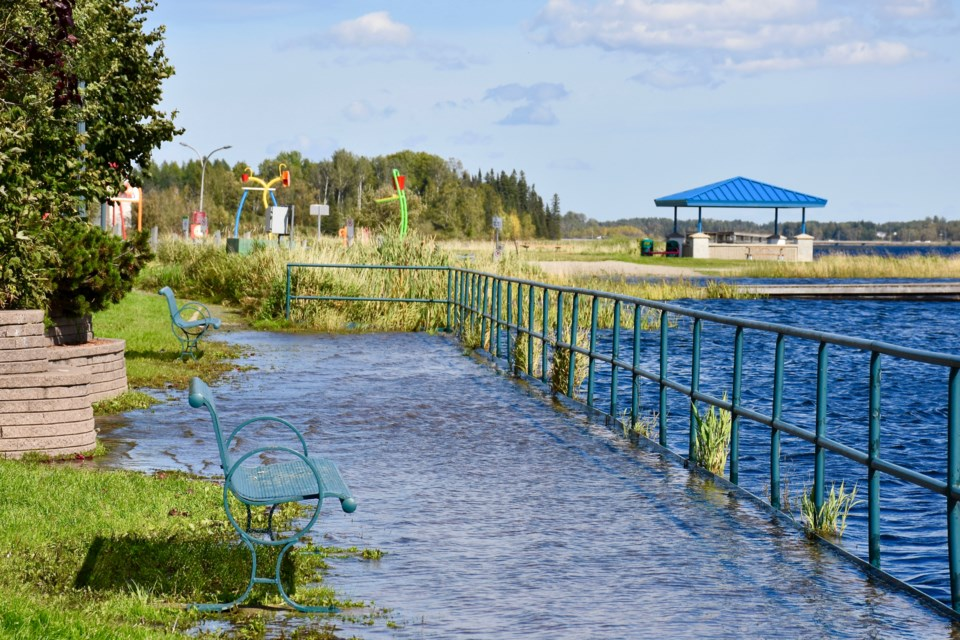 Water from Porcupine Lake spills over onto the boardwalk in South Porcupine.