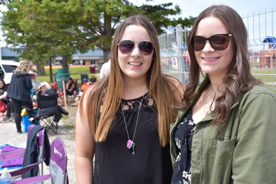 Sarah, left, and Ashley Guacci won meet and greets with Virginia to Vegas and Marianas Trench. The sisters camped out to be first into the Stars and Thunder grounds today. Maija Hoggett/TimminsToday