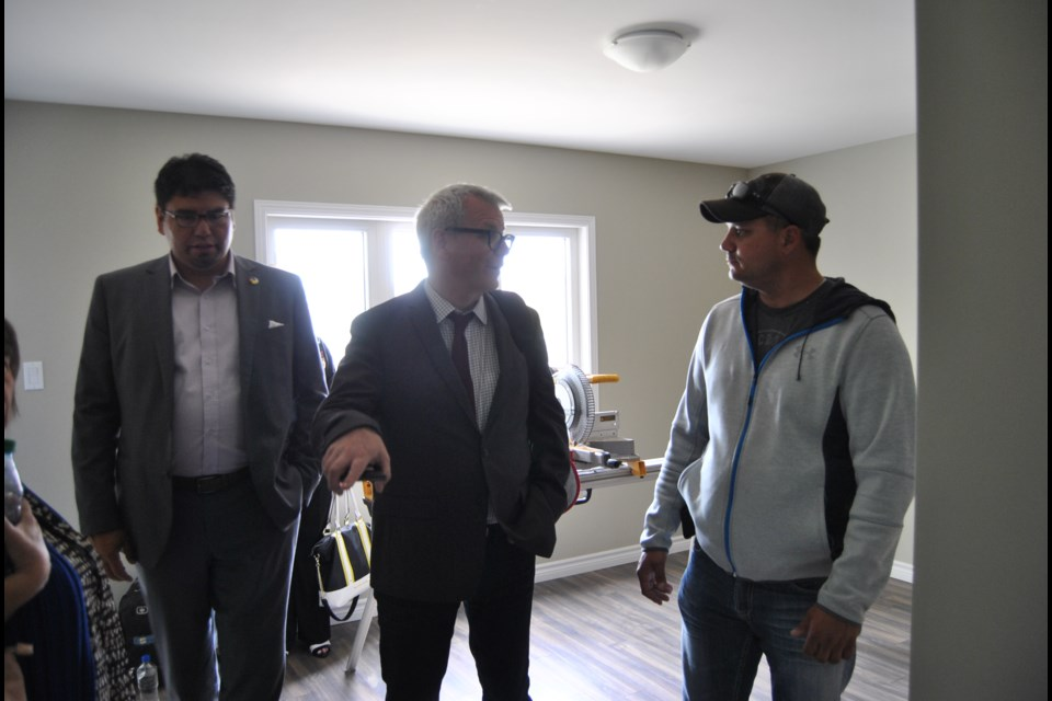 Adam Vaughan centre, the parliamentary secretary to the Minister for Housing and Urban Affairs tours a unit in the Timmins  Native Friendship Centre's housing development. On Vaughan's right is Pete Beaucage President of Praztek Construction, the company building the 18 units of affordable housing. Frank Giorno for TimminsToday