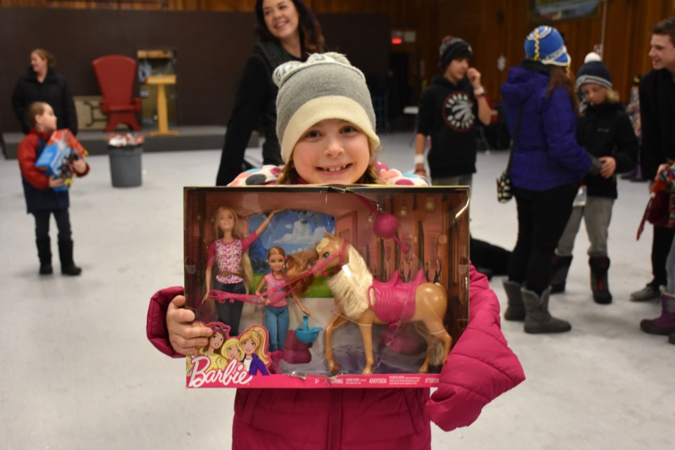 Grace Evans with the new Barbie horse set that she received at the F.W. Schumacher Gift Fund event. Maija Hoggett/TimminsToday