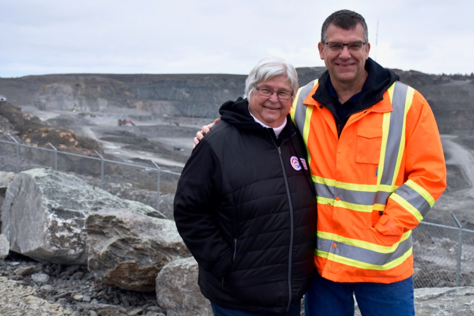 Helga Kroll and Newmont Goldcorp's Porcupine Gold Mine general manager Marc Lauzier at the lookout overseeing the Hollinger Open Pit. Maija Hoggett/TimminsToday