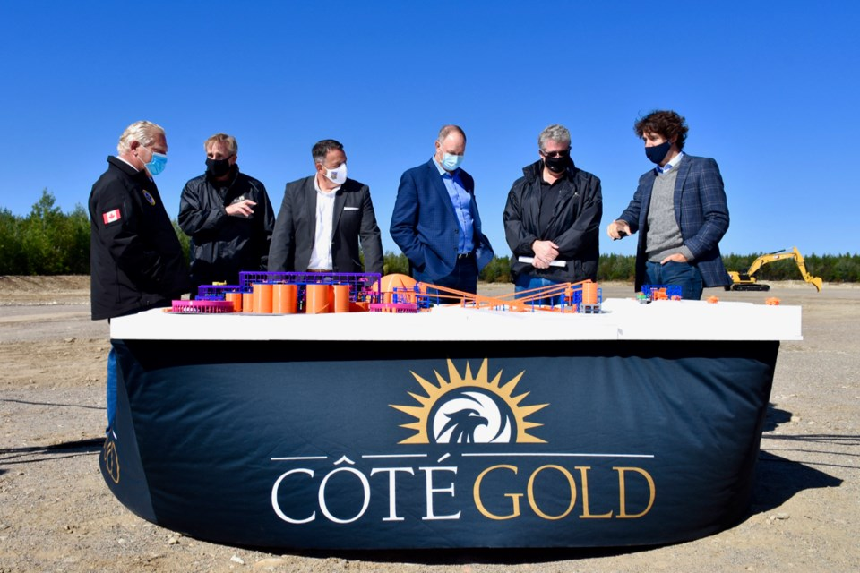 Ontario Premier Doug Ford and Prime Minister Justin Trudeau look at a model of the Côté Gold site after the groundbreaking. (Maija Hoggett/TimminsToday)
