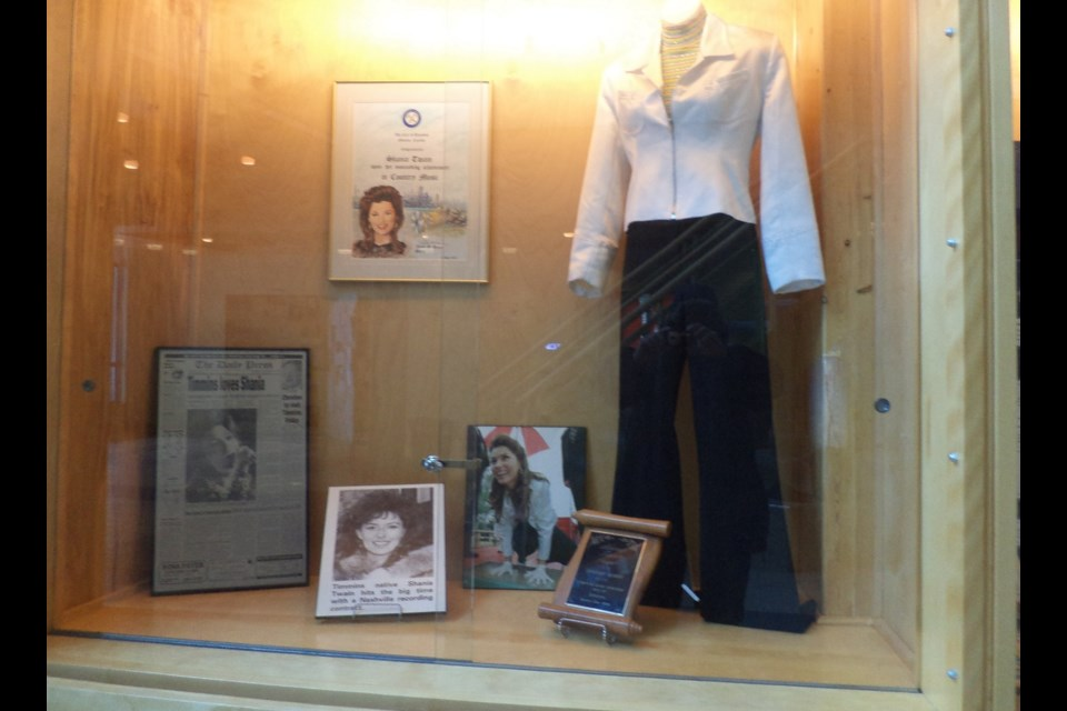 Shania Twain costume worn in concert on display by the entrance of the Timmins Public Library in Timmins. Is the city considering extending an invitation to Shania Twain and other musicians to perform in 2017? Frank Giorno for Timminstoday