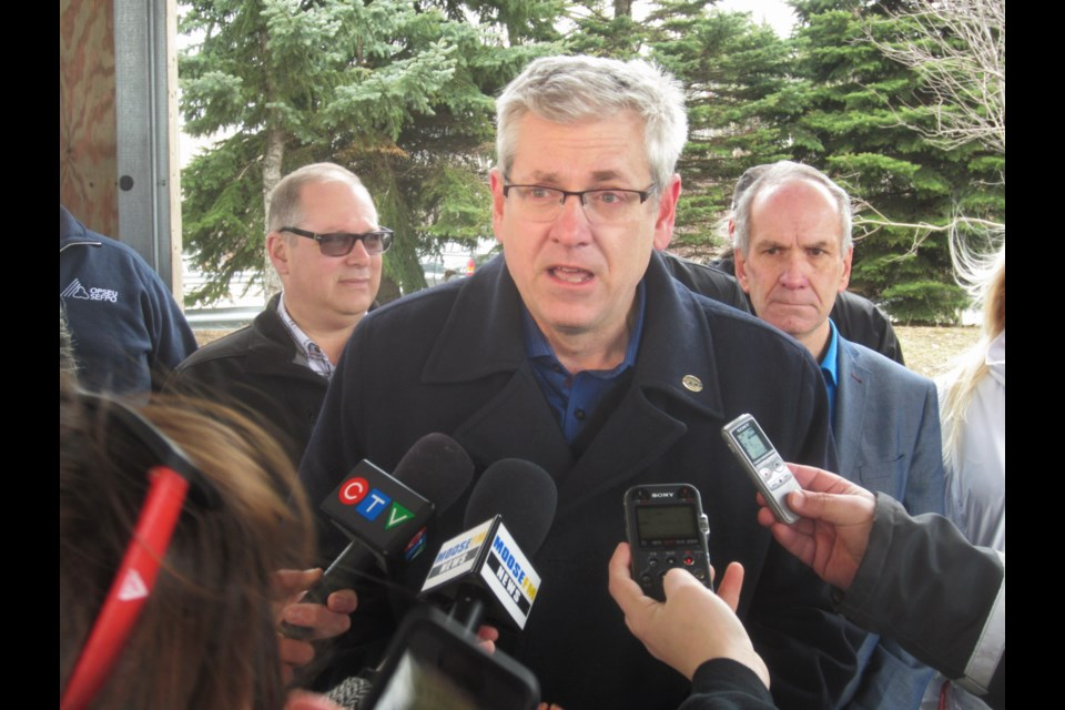 Federal NDP leadership candidate and Timmins-James Bay MP Charlie Angus speaks to reporters at Hollinger Park. Andrew Autio for TimminsToday