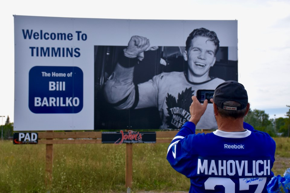 Wayne Bozzer snaps a picture of the new billboard honouring Bill Barilko. You can see it on the highway across from Bristol Road park on Porcupine Lake. Maija Hoggett/TimminsToday