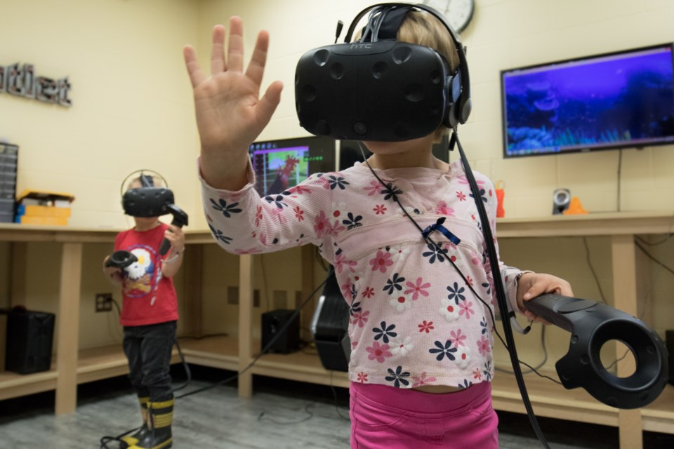 Children play games and explore virtual worlds using Northern College's new virtual reality machines. Jeff Klassen/TimminsToday
