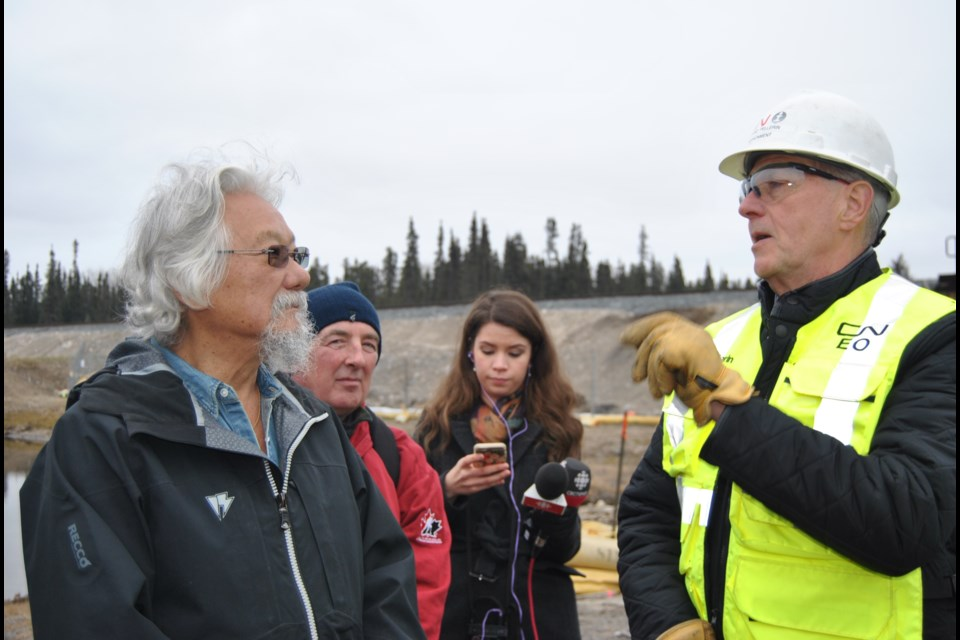David Suzuki (left) and Norman Pellerin, a CN spokesperson dialogue about the severity of the oil spill into the Mattagami River near Gogama as a result of a CN train derailment. Frank Giorno for TimminsToday