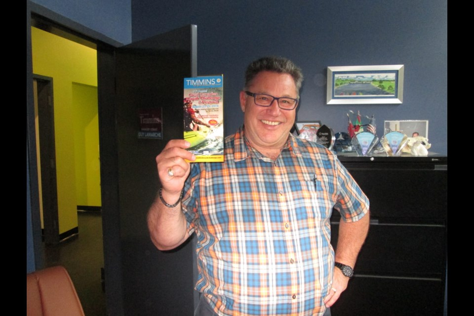 Guy Lamarche, manager of tourism and events for the City of Timmins, displays a flyer for the Great Canadian Kayak Challenge and Festival. Wayne Snider for TimminsToday