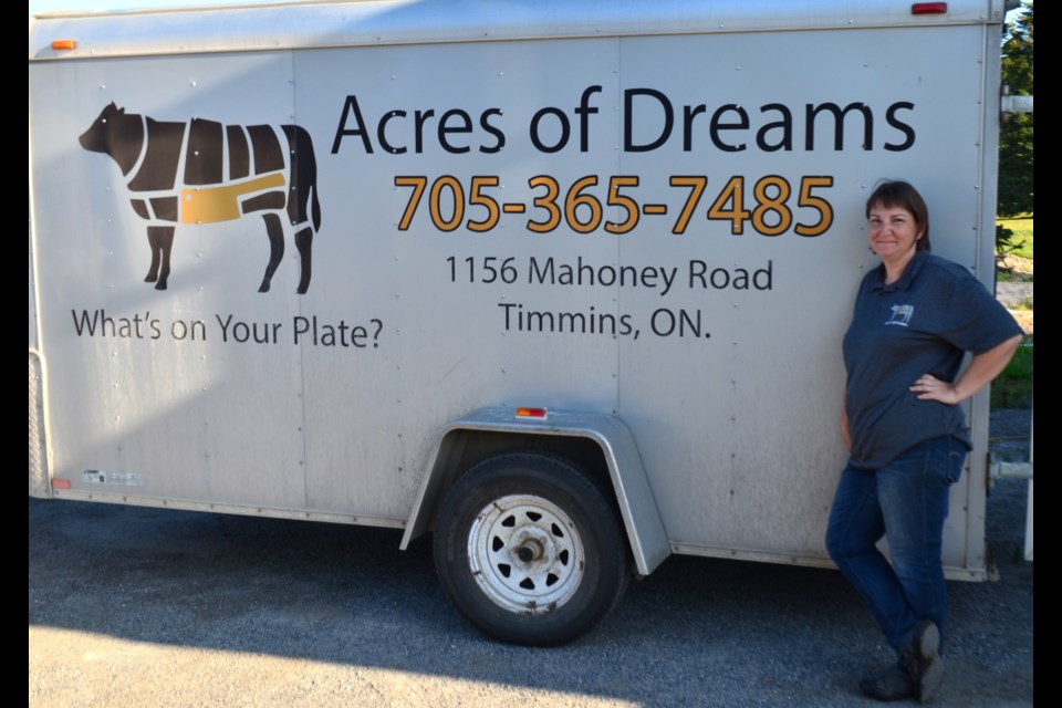 Patsy Schmidt displays the trailer for Acres of Dreams. She and her husband, Harold, have owned the farm on Mahoney Road since 2013. They have grown from just raising beef to adding chickens, eggs, and pork. Wayne Snider for TimminsToday