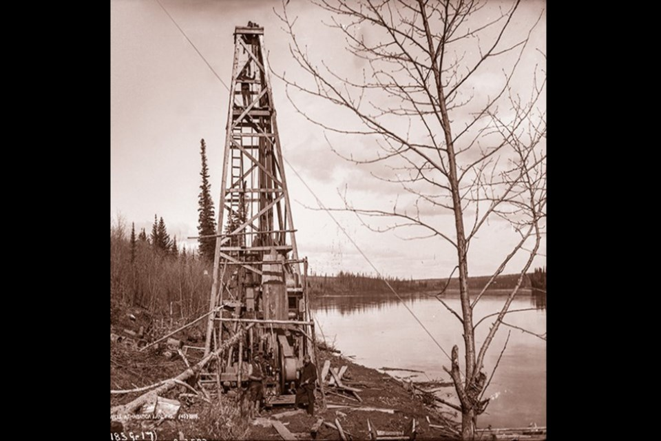 A historical picture, from the Athabasca Landing: An Illustrated History book, of the well drilled by A.W. Williams, as it was in 1894 before it was abandoned in 1896.