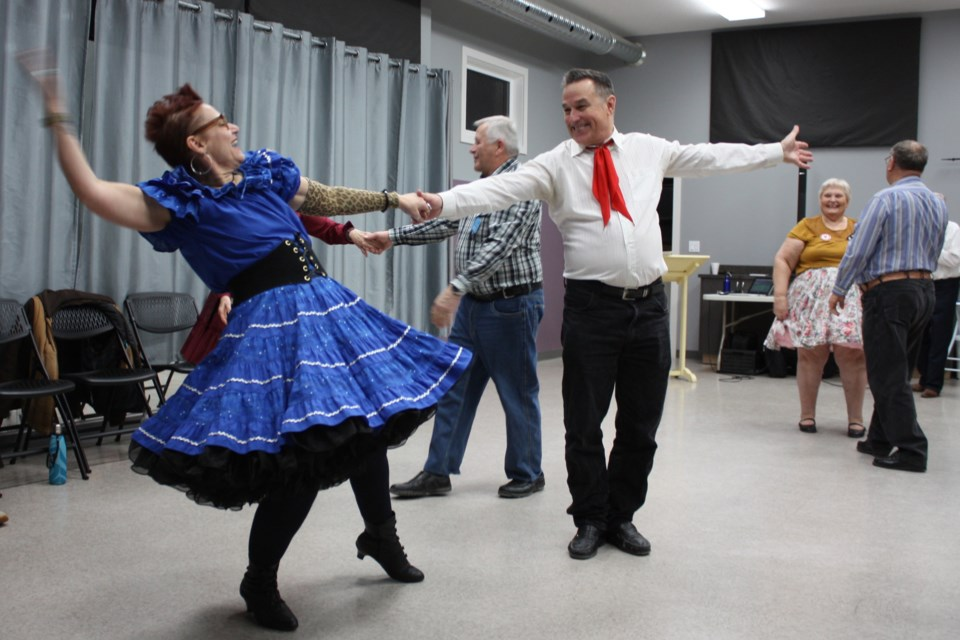 Susan Galloway and Bruno Wiskel put a little flourish at the end of square dancing at Turnabout Avenue Place in Athabasca Jan. 3. Heather Stocking/AA