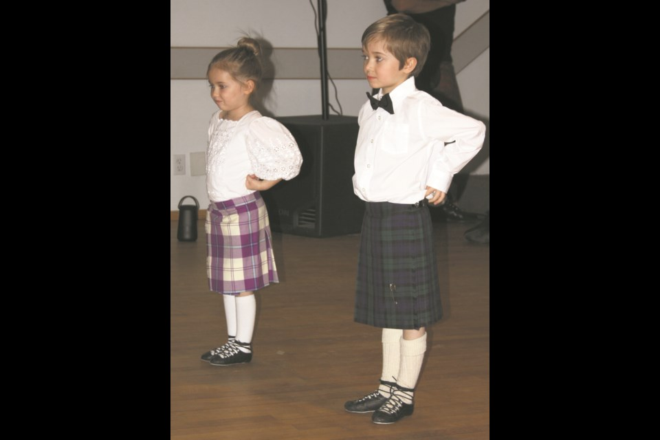Grace Anderson and Russell Anderson prepare to perform traditional Scottish dancing at the Rochester Robbie Burns Night Feb. 8. They are members of the Rochester Highland Dance group under instruction from Nicole Anderson.