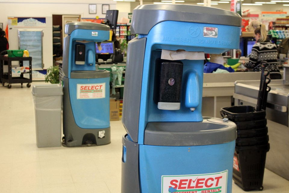 Tipton's Your Independent Grocer in Athabasca installed handwashing stations at the bagging end of tills to encourage patrons to follow proper hand hygiene before leaving the store.