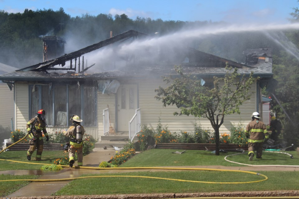 The Athabasca fire department responded to a house fire July 12 across from the Alice B. Donahue Library and Archives on 48 Street. The cause is under investigation but Athabasca fire chief Travis Shalapay said it is not considered suspicious. Heather Stocking/AA