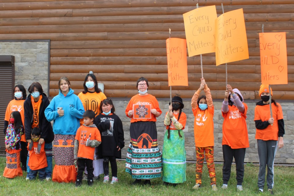 Some of the students from Calling Lake school participated in a second walk to remember children lost to residential schools Sept. 30, a day after the school-organized walk was ruined by a man yelling racial comments and insults at the teachers and youth.