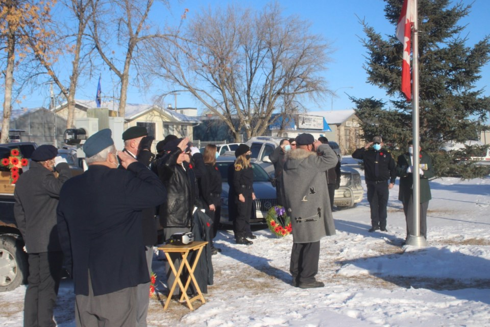 Members of the Royal Canadian Legion in Barrhead and others salute as the Canadian flag is lowered to half-mast at the Barrhead Memorial Park on Nov. 11. This year's Remembrance Day ceremony was fairly short due to the COVID-19 pandemic; normally, a lengthy ceremony would be held at the Barrhead Elementary School with hundreds in attendance. Even so, there were perhaps 40 to 50 residents in attendance at the brief ceremony.