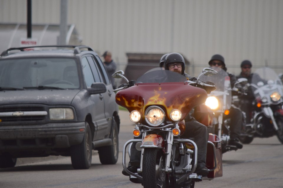 Don Smith leads out riders copy-motorcycle ride advancer