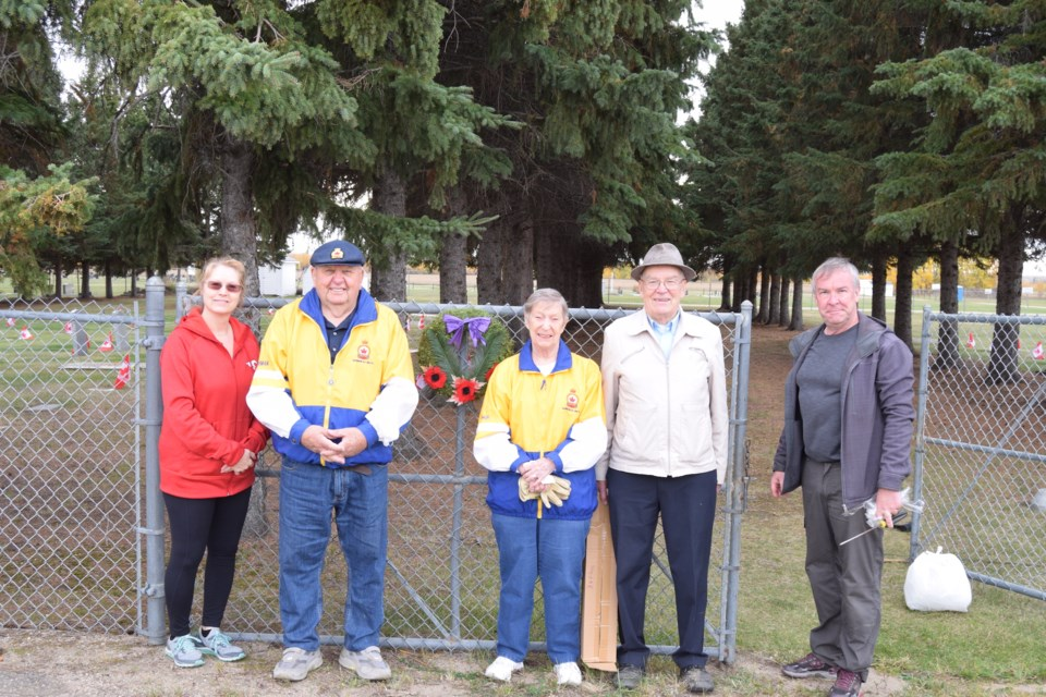 A small group of volunteers, comprised mostly of Royal Canadian Legion members, planted over 200 flags at Barrhead's Field of Honour on Oct. 2. Pictured from left are Town of Barrhead Coun. Shelley Oswald, Legion members Herman and Inga Barkemeyer, Legion vice-president Chuck Mortimer and his son Ed Mortimer.