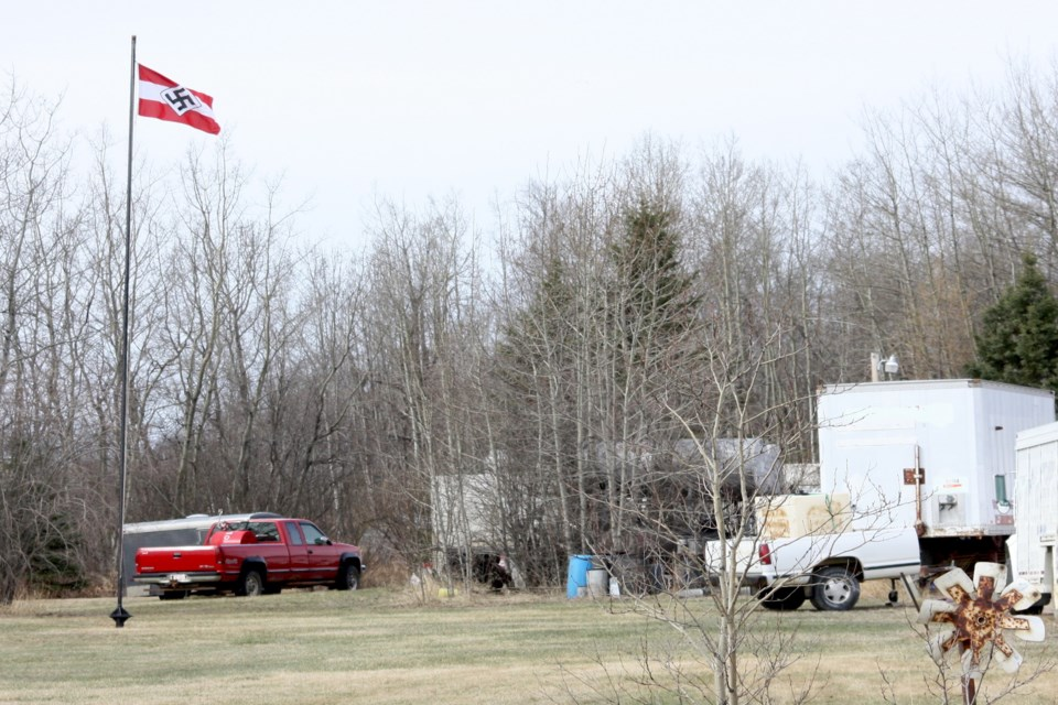 A Hitler Youth flag that was flying over a rural property just south of the Village of Boyle since at least Monday morning was voluntarily removed by the property owner after Boyle RCMP paid him a visit Wednesday evening.