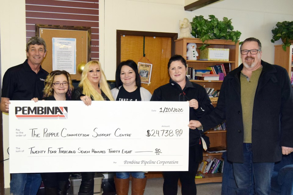 On Jan. 10, Pembina Pipelines donated $24,738.80 to the Ripple Connection Support Centre. L-R: Pembina Pipelines district manager John Pattyson, RCSC kitchen coordinator Gennie Williams, RCSC board chair Kristi McKort, administrative campaign chair Janie Freckelton and Pembina Pipelines supervisor Troy Wharton.