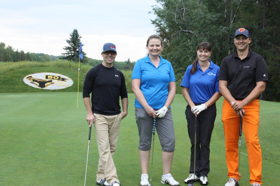 An overcast and drizzly morning gave way to a sunny afternoon as the Road to Hope Golf Classic returned to the Athabasca Golf & Country Club Sept. 9 with more than 100 golfers from around the region hitting the links in support of the organization whose volunteer drivers transport cancer patients to and from their treatments in the city. The Athabasca County foursome of Sheldon Schoepp, Sara Graling, Lorelei Sztym and Curtis Creaser pause for a photo after sinking their putts.