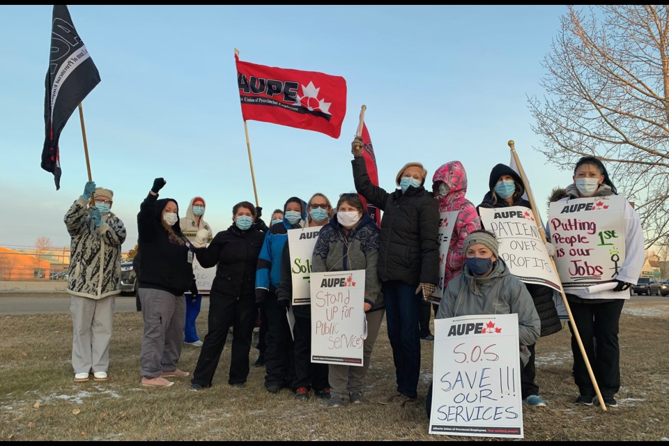 Alberta Union of Provincial Employees front-line health care workers across the province walked off the job Oct. 26, staging pickets like this one on 104 Ave in Westlock — similar scenes played out in Barrhead and Athabasca. George Blais/WN