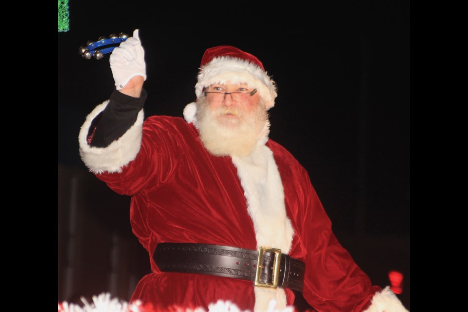 Santa Claus waved to the crowd during the Nov. 22 Light up parade through downtown Westlock.